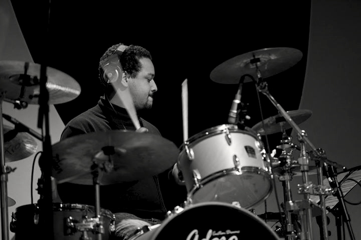 Drummer Michael Grimm hails from Hamburg, Germany. He discovered his passion for drums at 18 and, soon after, began playing djembe and drums in his mother's afro-soul band. His early band experience also includes a high school band with Jennifer Kiek, today known as Y'Akoto. Michaels went on to play on tours with acclaimed reggae singer, Pat Curvin and reggae-soul singer, Nneka. As of 2009, he is also permanent member of performer Samy Deluxe's band and tours regularly with him throughout Germany.