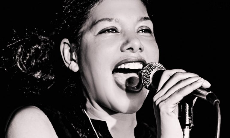 """Saudia Young  is a Jazz & Blues inspired singer and stage performer from New York City. After studying theater, dance, and voice, she established herself as a respectable artist on the German and American music scene. Her two Solo EPs include """"Artboy Love"""" (2007) and the self titled """"Saudia Young"""" (2013). Saudia regularly performs with her Rockabilly Blues Band at night clubs in Berlin."""